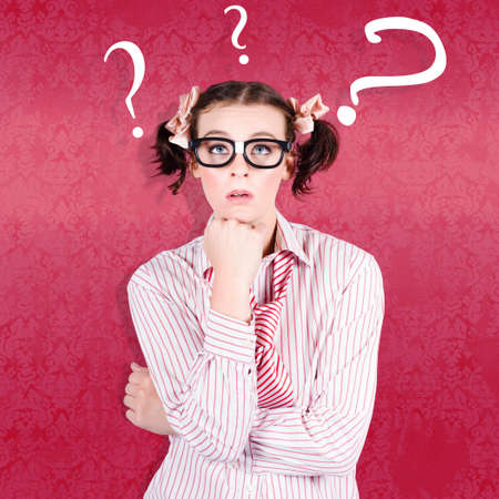 seeking solution: Uncertain Geeky Woman Seeking The Solution To A Problem With Question Mark Symbols Above Her Head On Copy Space Background Stock Photo