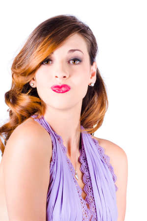 flying kiss: Portrait of beautiful woman in dress with red lipstick blowing kiss, white background