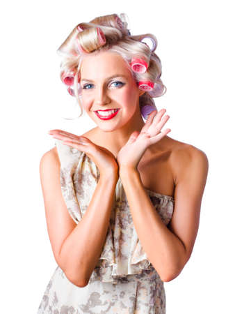 rollers: Half body portrait of happy young woman with rollers in curly blond hair, white background
