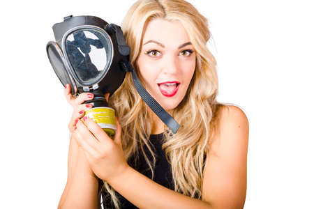 gas: Close photo on the face of a woman in fear holding gas mask in white background warfare. Terror alert Stock Photo