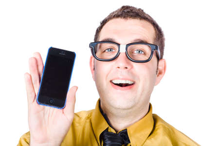 telephoning: Isolated picture of a amazed dorky man holding a mobile smartphone with blank copyspace screen on white background