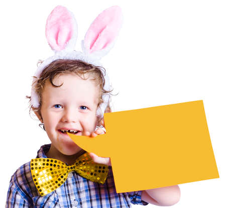 bunny ears: Smiling young boy wearing pink bunny ears of an Easter bunny with blank yellow bubble sheet isolated on white Stock Photo