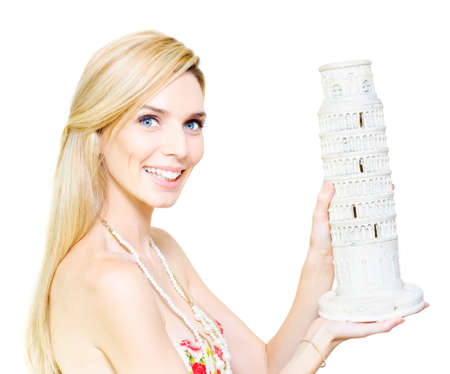 fulfilment: Woman holding a ceramic ormnament of the Leaning Tower of Pisa in her hands as she fantacises about undertaking a journey of adventure to explore historical architectural tourist destinations Stock Photo