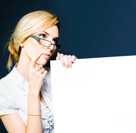 speculating: Picture of a cute blonde female tax accountant in glasses holding blank sign board to display information about discounts on returns and savings on accounting