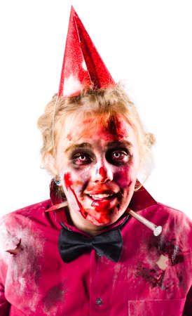 grisly: Smiling woman in bloody Halloween costume with party hat, white background