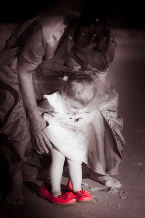 love life: Love And Trust Sees A Beautiful And Special Moment Captured As A Mother  Grandmother Helps Her Baby Daughter  Granddaughter Take Her First Steps In Life Stock Photo
