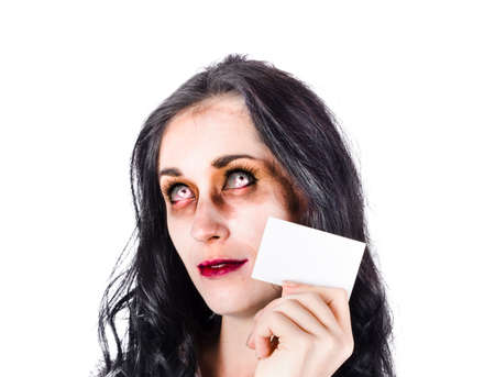 unsightly: Portrait of female zombie with business card, bad branding concept on white background