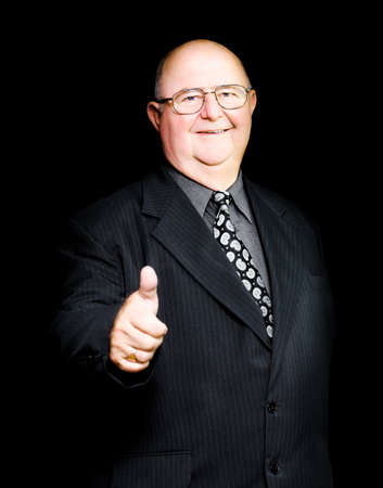 portly: Enthusiastic positive senior business man on the brink of retirement giving a thumbs up gesture of approval