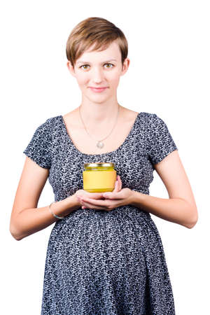 naturopath: Holistic female naturopath holding jar of homemade spread made with organic ingredients Stock Photo