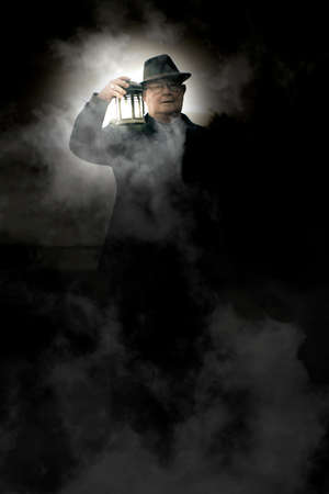 cemetry: Frightened And Spooked Senior Man Walking Around A Foggy Cemetery At Midnight With A Lit Up Lantern When Working The Graveyard Shift