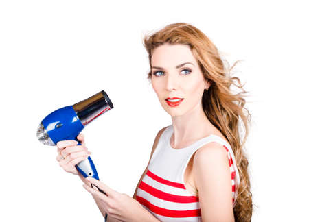 tresses: Gorgeous photograph of an attractive lady holding hair dryer. Blow dry hair style