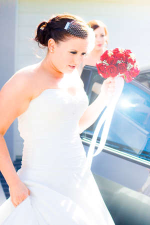 fashionably: Bride Running Fashionably Late To The Wedding Ceremony Runs To The Bridal Car In A Rushing Marrige Moment Stock Photo
