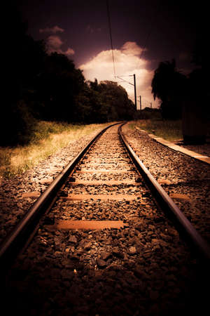 railway transportation: Train Tour Of Darkness With Railway Tracks Leading Off Into The Vast Expansive Empty Distance In A Dark And Moody Transportation Journey