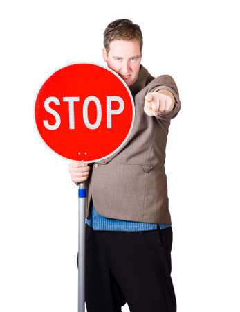 wait sign: Isolated man holding red traffic stop sign over white background Stock Photo