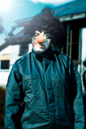 scary clown: Half Body Portrait Of Scary Clown With Curl Black Wig Red Nose And Leather Style Coat Outdoors Stock Photo