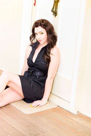 doorstep: A Female Brunette Beauty Waiting In Anticipation Eagerness And Hope By The Doorstep Of A Residential Home In A Real Estate And Property Concept
