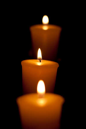 alight: 3 Candles Alight On A Candelabra