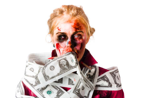 silenced: Worried blond female zombie with facial injuries and covered in blood surrounded by Dollar bills isolated on white background Stock Photo