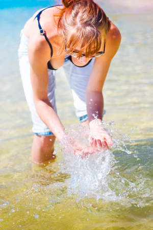 retreat: Lady Traveler Cooling Down While Wading And Splashing Around In Shallow Sea Water While On A Coastal Retreat Downunder To Humid And Temperate Australia