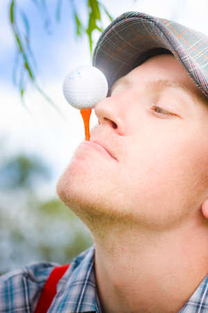 steadiness: Golfer Man On Vacation Balances His Golf Ball On A Golfing Tee In A Golf Stability And Steadiness Concept In The Balance Of Golf Practice