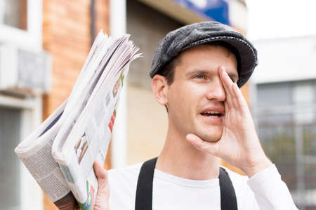 Calling For Buyers A Spruiker News Paper Boy Yells Out Loudly Extra Extra Read All About It