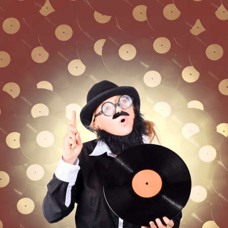 dweeb: Concept image of a comical female model on a music high holding a LP Vinyl Disc Stock Photo