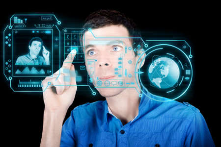 compute: Young Man Using A Virtual Touchscreen Computer Interface With Cloud Data To Compute Analytics And Utilise Global Connections