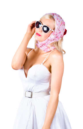 head scarf: Classic 1950s pin-up woman in classy white dress, head scarf and sunshades, white background