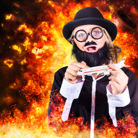 coercion: Artistic photo illustration of a comical bearded terrorist hyjacking a model plane in flames and fire