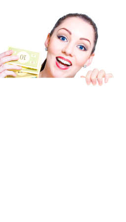 discounting: Isolated Face Of An Excited And Joyous Female Retail Shopper Holding A Handful Of Money When On A Shopping Spree In A Discounting And Lower Prices Concept