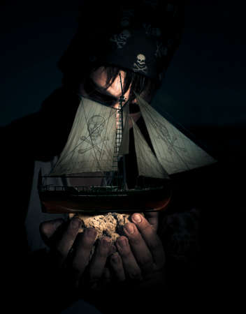 gaff: Monster Pirate Standing On A Beach In The Dead Of Night Holds A Skull And Crossbones Pirate Ship On A Handful Of Sand In A Ocean Treasure Concept