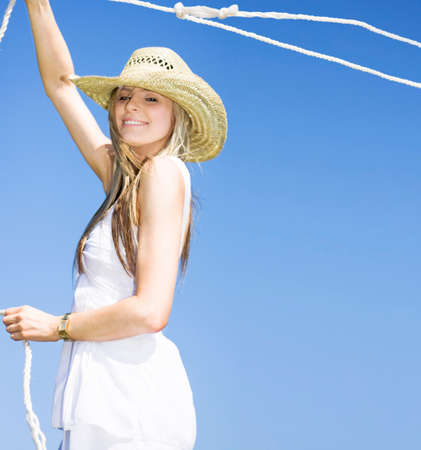 farm girl: A Outdoor Farm Girl Lassos A Rope In The Blue Sky Breeze Catching A Grab Of The Farmyard Life