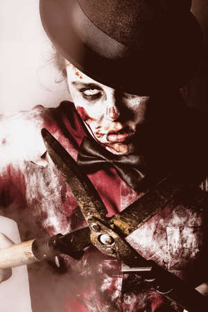 reanimated: Spooky zombie slicing and dicing victims with gardening shears in midnight terror Stock Photo