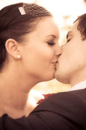 passionate kiss: Bride And Groom Engrossed In A Passionate Kiss At A Wedding Alter
