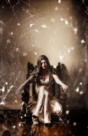 girl mouth: Dark portrait of a possessed demon woman  seated in haunted house in vintage fashion with spiderweb. Devil is in the details