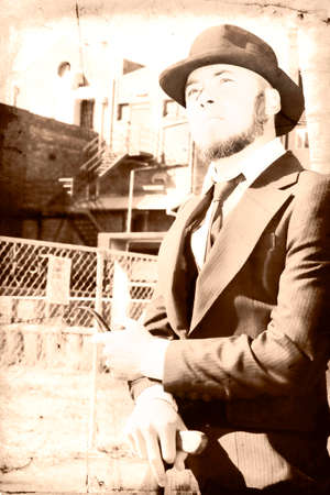 clergyman: Vintage Style Suited Man Standing Outside Building Reflecting On The Past