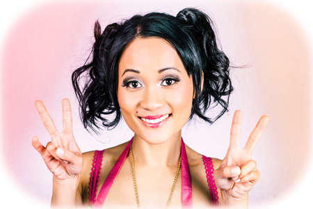 counterculture: Retro asian girl wearing heart shape makeup with adorable hairstyle gesturing peace love and hope Stock Photo