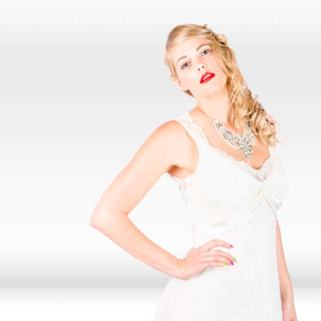 studio photograph: Full Body Studio Photograph Of A Beautiful Young Blonde Woman In Wedding Fashion And Jewellery