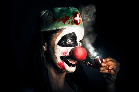 evil clown: Fine art horror portrait of a bad surgeon clown smoking pipe after blood surgery