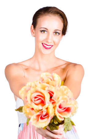 combed: Beautiful young brunette woman holding a bouquet of fresh florist flowers. Isolated on white Stock Photo