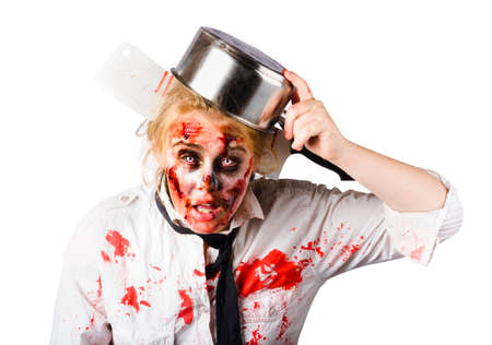 white color: Frustrated blond woman with pan on her head having had an accident making strawberry jam which is now covering her face and shirt
