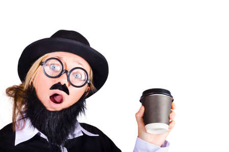 disguised: Woman disguised as man with hat and beard holding cup of coffee in plastic cup, white background