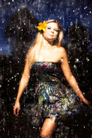 miniskirt: Grunge Portrait Of Sexy Woman In Rain. Grunge portrait of a sexy blonde woman with a hibiscus in her hair dancing in the rain in a miniskirt