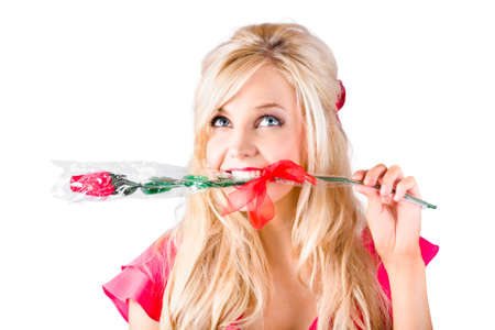 teeth smile: Portrait of blond woman with single red rose between teeth, white background
