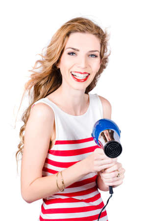 scintillating: Happy female hairdresser laughing when shooting hair dryer. Hot hairstyle Stock Photo