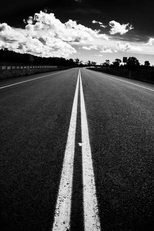 asphalt: Vast Expansive Black & White Emptiness. This Is The Road I'm Travelling. This Is Middle Road.