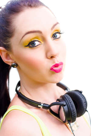80s Woman Wearing Retro Headphones Pushes Lips Together In A Kissing Expression In A Sound Showing Of Music Love, Etched Studio Image On White Background