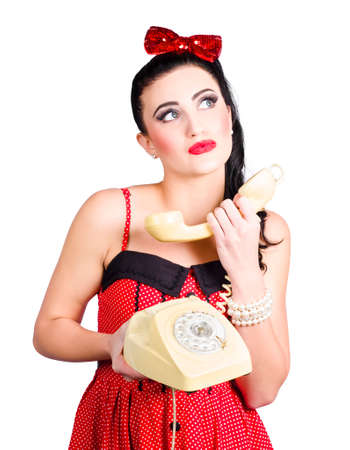 daydreamer: Comic pinup woman chatting down the telephone line during a sixties phone conversation Stock Photo