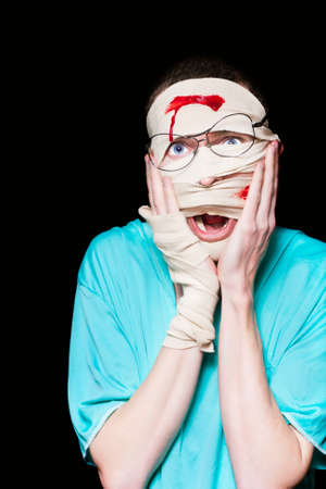 excruciating: Bandaged Patient Nursing A Broken And Bloody Head Expressing Confusion And Distress Over A Shocking Work Injury