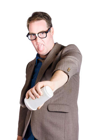tastes: Male office worker pouring out hot drink with look of distaste. Bad coffee Stock Photo
